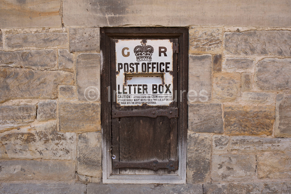 Very old post box collection letter box from the British Post Office near to Hever, England, United Kingdom.