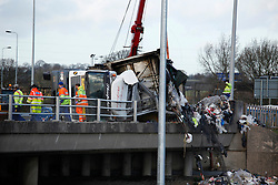 © Licensed to London News Pictures. 5/1/2012, Coventry, UK. The M6 was closed earlier today causing miles of traffic tailbacks when a high sided vehicle was blown over by winds on the bridge over junction two of the motorway in Coventry. The vehicle spilt its waste contents onto the motorway below, causing Motorway Police to seal off the busy M6 southbound for several hours. Photo credit : Dave Warren/LNP