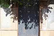 Door and shadow in Manzanillo, Granma, Cuba.