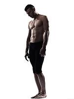 caucasian man gymnast acrobat portrait isolated studio on white background