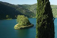 Oćuša jezero, one of the Baćinska Jezera (Lakes of Baćina), and mediterranean cypress (Cupressus sempervirens). Delta of the Neretva river (trans-boundary area Croatia/Bosnia-Herzegovina),  Dalmatia region, Croatia.  May 2009.<br /> Elio della Ferrera / Wild Wonders of Europe