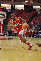 """31 January 2009: Dodie Dunson charges past the 3 point arc. The Illinois State University Redbirds join the Bradley Braves in a tie for 2nd place in """"The Valley"""" with a 69-65 win on Doug Collins Court inside Redbird Arena on the campus of Illinois State University in Normal Illinois"""