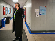 14 JANUARY 2020 - DES MOINES, IOWA: Terry McAuliffe TERRY MCAULIFFE, former Democratic Governor of Virginia and former chairman of the Democratic National Committee makes a cell phone call in the hallway of the media workspace at the CNN Democratic Presidential Debate on the campus of Drake University in Des Moines. This is the last debate before the Iowa Caucuses on Feb. 3.   PHOTO BY JACK KURTZ