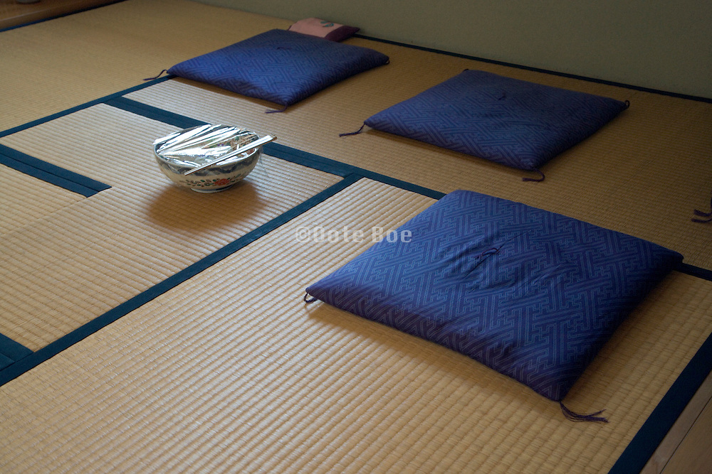 cushions and bowl in a tea ceremony room