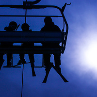 Skiers ride up in a ski lift Friday, February 26, 2021.