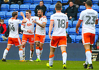 Blackpool's Kyle Vassell celebrates scoring his side's first goal with teammates Callum Cooke and Jimmy Ryan<br /> <br /> Photographer Alex Dodd/CameraSport<br /> <br /> The EFL Sky Bet League One - Oldham Athletic v Blackpool - Monday 2nd April 2018 - Boundary Park - Oldham<br /> <br /> World Copyright © 2018 CameraSport. All rights reserved. 43 Linden Ave. Countesthorpe. Leicester. England. LE8 5PG - Tel: +44 (0) 116 277 4147 - admin@camerasport.com - www.camerasport.com