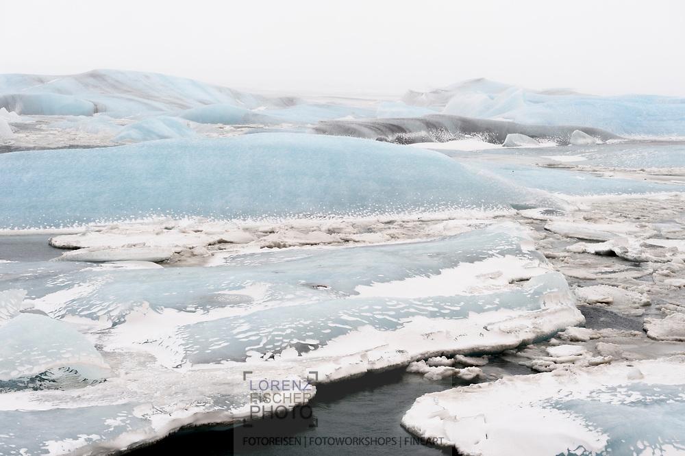 The glacier lagoon Joekulsarlon on a blizzard in wintertime, Iceland