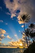 The sun rising between the Mokulua Islands, Lanikai Beach, Kailua, Oahu, Hawaii