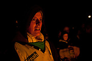 A female tar barrel runner looks on in the glow of the flames. The annual running of the tar barrels in Ottery St Mary, Devon is a tradition thought to go back as far as 500 years. Every November the 5th, crowds of thousands flock to this small town in the south west of England to see men, women and children run with burning barrels on their shoulders. Only people who were born in Ottery are allowed to participate, and they are proud of the tradition and work hard to keep it alive, even in the face of health and safety regulations. It is not competitive but rather a supportive act where they pass the barrels between themselves, encouraging everyone in the team to have a go.