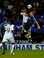 Fotball<br /> England 2005/2006<br /> Foto: SBI/Digitalsport<br /> NORWAY ONLY<br /> <br /> Bolton Wanderers v Newcastle United. The Barclays Premiership. 24/08/2005.<br /> <br /> Bolton's Abdoulaye Faye gets his hand to the ball to deny Newcastle's Alan Shearer (R).