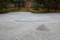 At Kodai-ji temple there are several formal gardens designed by Kobori Enshu, a master Zen gardener.   Kodaiji's south garden is a karesansui, or dry rock garden featuring a large area of raked gravel,  punctuated by conical gravel formations and surrounded by a border of moss and stone. The raked gravel of a karesansui is meant to evoke the ripple patterns that form in water.