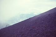 Adventure travel, people climbing active Pacaya volcano, Guatemala, central America,