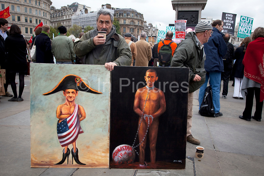 """Painting of Obama with a ball and chain and Sarkozy draped in the US flag. Protest in central London to mark 10 years of the conflict in Afghanistan. Musicians, actors, film-makers and MPs are joining protesters for the Anti-war Mass Assembly in Trafalgar Square. The Stop The War Coalition said up to 5,000 people were at the protest but a BBC correspondent estimated there were about 1,000 people in the square. The coalition says opinion polls show most British people want a """"speedy withdrawal"""" of UK forces. The demo brought together people from many groups in solidarity."""