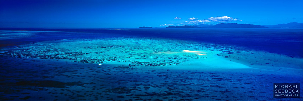 An aerial panoramic view of Upolu Cay on the Great Barrier Reef offshore from Cairns, captured on an idyllic day.<br /> <br /> Code: HAQI0011<br /> <br /> Limited Edition Print