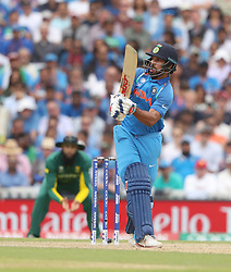 India's Shikhar Drawn hits out for four runs during the ICC Champions Trophy, Group B match at The Oval, London.