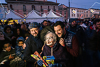 BONDENO, ITALY - 6 JANUARY 2020: Matteo Salvini, former Interior Minister of Italy and leader of the far-right League party, poses for a pictures with the Befana in Bondeno, Italy, on January 6th 2020.<br /> <br /> In Italian folklore, Befana is an old woman who delivers gifts to children throughout Italy on Epiphany Eve (the night of January 5) in a similar way to St Nicholas or Santa Claus.<br /> <br /> Matteo Salvini is campaigning in the region of Emilia Romagna to support the League candidate Lucia Borgonzoni running for governor.<br /> <br /> After being ousted from government in September 2019, Matteo Salvini has made it a priority to campaign in all the Italian regions undergoing regional elections to demonstrate that, in power or not, he still commands considerable support.<br /> <br /> The January 26th regional elections in Emilia Romagna, traditionally the home of the Italian left, has been targeted by Matteo Salvini as a catalyst for bringing down the government. A loss for the center-left Democratic Party (PD) against Mr Salvini's right would strip the centre-left party of control of its symbolic heartland, and probably trigger a crisis in its coalition with the Five Star Movement.
