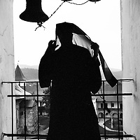 Neamt County, Romania July 2007<br /> A monk preparing to call for mass in the steeple of Neamt monastery.<br /> Photo: Ezequiel Scagnetti