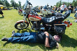Relaxing at the 3rd Annual FXR Show at City Park during the 75th Annual Sturgis Black Hills Motorcycle Rally.  SD, USA.  August 2, 2015.  Photography ©2015 Michael Lichter.