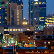 Slice of Kansas City, MO downtown skyline with Crossroads District in foreground and skyline highrises in background.