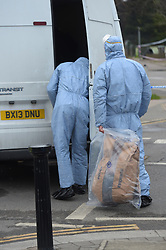 © Licensed to London News Pictures, 17/03/2018. London. UK, Police and forensic officers at the scene in South Street, Enfield where a male in his 20s was found with fatal gun shot wounds, another male in his 20s was taken to an East London hospital with stab wounds which are thought to be non life threatening Photo credit: Steve Poston/LNP