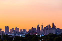London, August 16 2017 . The colours of the sky change minute by minute as the city skyline is illuminated by the morning light as London wakes up to a glorious sunrise. © Paul Davey.