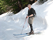 a man crosscountry skis on a groomed trail at Mount Tahoma Trails, Ashford, WA, USA