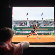 PARIS, FRANCE May 29. A ball boy watches from the pit window as Johanna Konta of Great Britain plays against Lauren Davis of the United States on Court One in the Women's Singles second round match at the 2019 French Open Tennis Tournament at Roland Garros on May 29th 2019 in Paris, France. (Photo by Tim Clayton/Corbis via Getty Images)
