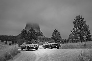 """BOLO Photo<br /> Wild West Automotive Photography<br /> """"Out of the Storm""""<br /> August 17, 2019: Devils Tower, Wyoming<br /> (1979 Pontiac Trans Am: Heather Wendelboe)<br /> (1987 Buick Turbo T: Wayne Emmons)"""