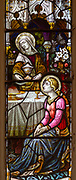 Stained glass window detail of Mary at table, church of Saint Margaret, Linstead Parva, Suffolk, England, UK circa 1890s