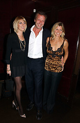 Left to right, LADY EMILY COMPTON, HUGO BURNAND and the MARCHIONESS OF MILFORD HAVEN at The Christmas Cracker - an evening i aid of the Starlight Children's Charity held at Frankies, Knightsbridge on 13th December 2006.<br />