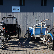 Bikes parked up. Lundtoftegade is a housing estate in the heart of Copenhagen. The estate has been on the controversial Ghetto List for years but wastaken off 1st of December 2020. The Ghetto List is based on the Ghetto Law introduced by the Danish Govenrment in 2018. In 2020 a huge campaign was launched to raise 50.000 signatures demanding the Danish Parliament to reconsider the law and to abolish it. Part of the campaign was the national portrait poster campaign 'We ARE the mixed city'. More than 100 local residents in joined the campaign and were photographed in a small make shift studio set up in Lundtoftegade. These images are fragments of life in and around Lundtoftegade 2020.