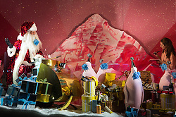 © Licensed to London News Pictures. 20/10/2016. Finishing touches are made as SELFRIDGES department store is the first retailer in the world to unveil its Christmas windows with a theme of Santa Claus partying and having fun in a variety of settings. London, UK. Photo credit: Ray Tang/LNP