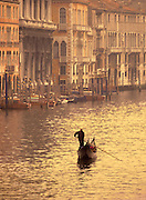 Image of a gondolier rowing his gondola along the Grand Canal of Venice, Italy by Randy Wells