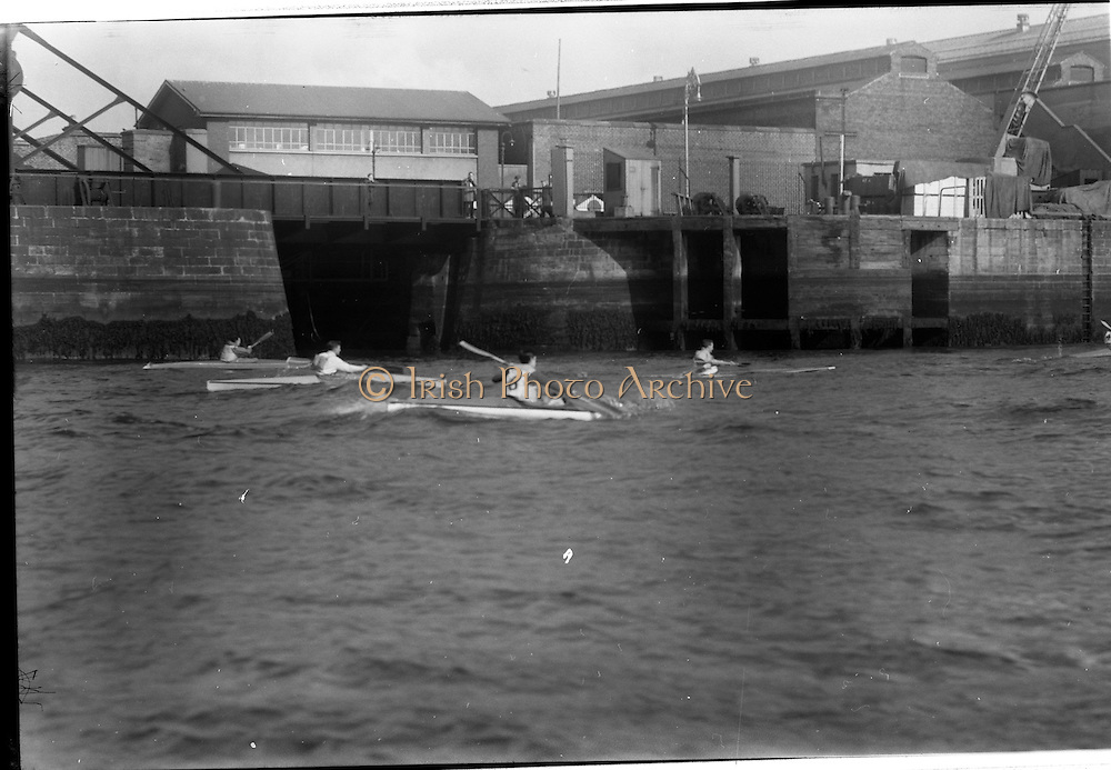 08/03/1964<br /> 03/08/1964<br /> 08 March 1964<br /> Views at the port of Dublin. View of canoeing on the Liffey. CHQ, BUILDING,