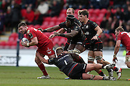 Rob Evans of Scarlets (l) tries to break past Maro Itoje © and Richard Barrington of Saracens (no1).  European rugby Champions cup match, pool 3, Scarlets  v Saracens at the Parc y Scarlets in Llanelli, West Wales on Sunday 15th January 2017.<br /> pic by  Andrew Orchard, Andrew Orchard sports photography.