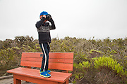 Young boy taking photos with a camera, Elfin Forest, Baywood Park, San Luis Obispos County, California, USA (MR)