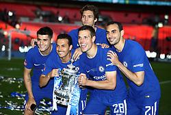 Left right right, Chelsea's Alvaro Morata, Pedro, Cesar Azpilicueta, Marcos Alonso and Davide Zappacosta celebrate with the FA Cup trophy