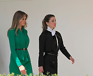 First Lady Melania Trump and Queen Rania of Jordan walk from the Rose Garden to the White House.<br /> Photo by Dennis Brack