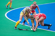 Katelyn Falgowski of the USA tackles Australia's Casey Eastham during their match in the Investec Hockey World League Semi Final 2013, Quintin Hogg Memorial Sports Ground, University of Westminster, London, UK on 27 June 2013. Photo: Simon Parker