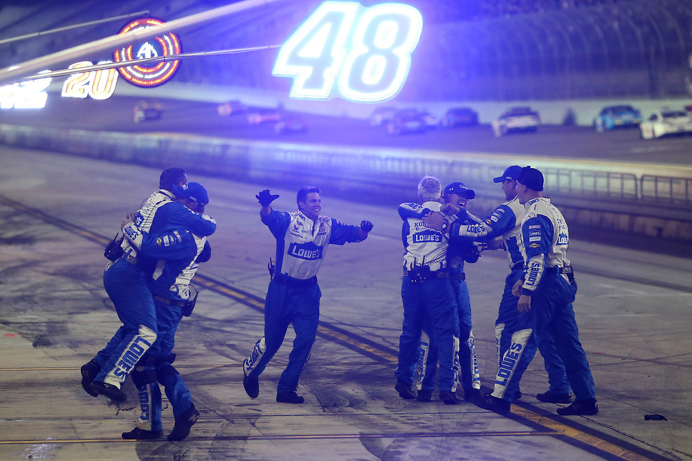 Nov 20, 2016; Homestead, FL, USA; The crew of NASCAR Sprint Cup Series driver Jimmie Johnson (48) celebrates after winning the NASCAR Spring Cup Championship after the Ford Ecoboost 400 at Homestead-Miami Speedway. Mandatory Credit: Peter Casey-USA TODAY Sports
