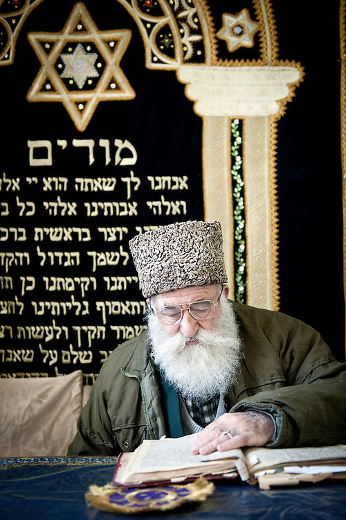 USE ARROWS ← → on your keyboard to navigate this slide-show<br /> <br /> Bukhara, Uzbekistan 23 March 2012<br /> Rabbi Araon Sianov reads the Torah in a synagogue of Bukhara.<br /> Bukharan Jews, also Bukharian Jews or Bukhari Jews are Jews from Central Asia who speak Bukhori, a dialect of the Tajik-Persian language.<br /> Their name comes from the former Central Asian Emirate of Bukhara, which once had a sizeable Jewish community. <br /> The great majority of Jews of Bukhara have emigrated to Israel or to the United States while others have emigrated to Europe or Australia.<br /> Photo: Ezequiel Scagnetti