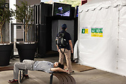 A man watches a television broadcasr of the men's cycling road individual time trial during the Tokyo 2020 Olympic Games at the Fuji International Speedway in Shizuoka prefecture on July 28, 2021. - At the Fuji Speedway venue, around 100 kilometres (60 miles) from Tokyo, the rules on July 28 allowed for 10,000 spectators, less than half the venue's full capacity of 22,000. (Photo by Yuki IWAMURA / AFP)