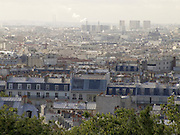 view of Paris with smokestacks in the background