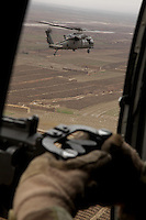 Black Hawk UH-60 Helicopters in convoy over western Kandahar.