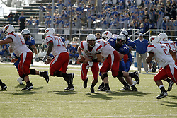 25 November 2006: Luke Drone steps to the backfield to hand off to Rafael Rice.&#xD;The Redbirds romped the Panthers by a score of 24-13.&#xD;This game was a 1st round NCAA Division 1 Playoff held at O'Brien Stadium on the campus of Eastern Illinois University in Charleston Illinois.<br />