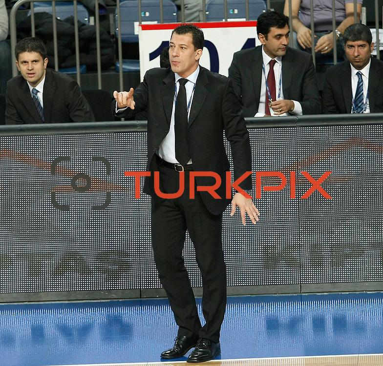 Anadolu Efes's coach Ufuk Sarica during their Turkish Basketball League match Anadolu Efes between Trabzonspor at Sinan Erdem Arena in Istanbul, Turkey, Saturday, December 10, 2011. Photo by TURKPIX