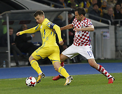 October 9, 2017 - Kiev, Ukraine - Mykola Matviyenko of Ukraine (L) vies for the ball with Milan Badelj (R) of Croatia during the 2018 FIFA World Cup qualifying soccer match between Ukraine and Croatia at the Olimpiyskyi stadium in Kiev, Ukraine, 09 October 2017  (Credit Image: © Str/NurPhoto via ZUMA Press)