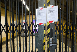 © Licensed to London News Pictures. 19/03/2020. London, UK. A sign outside Barbican tube station near St Bartholomew's Hospital in London which is seen closed this morning. Transport for London (TfL) are closing a number of underground stations from today, as partial closure of the tube and rail network begins in response to the growing coronavirus outbreak in the captial. Photo credit: Vickie Flores/LNP