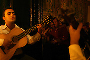 """A couple enjoy Fado at Audience at restaurant """"Mesa de Frades"""", an old chapel in Alfama typical neighborhood"""