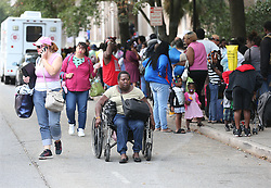 Michelle Wright, 50, arrives in her wheelchair joining hundreds of local residents being evacuated from the city at the Savannah Civic Center during a mandatory evacuation for Hurricane Irma on Saturday, September 9, 2017, in Savannah, Ga. Officials are expecting 1,500 to 3,000 without transportation to leave by buses that are being provided. Photo by Curtis Compton/Atlanta Journal-Constitution/TNS/ABACAPRESS.COM